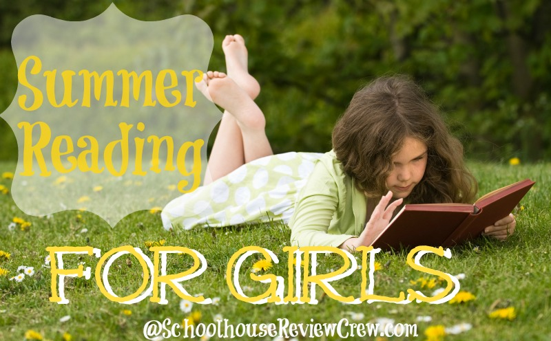 Young girl reading a book in a grassy meadow covered with wild flowers